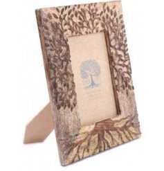 A natural carved wooden photo frame with the Tree Of Life decal.