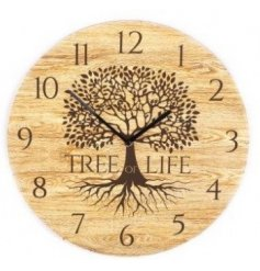 A natural wooden clock with painted black Tree of Life decal.
