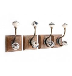 An assortment of natural based wall hooks with vintage inspired white and black patterned ceramic knobs
