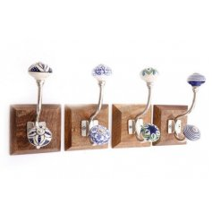 An assortment of natural based wall hooks with vintage inspired blue and white patterned ceramic knobs