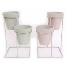This assortment of double planters comes in a soft Sage Green and charming subtle grey tone