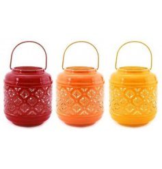 this mix of decorative lanterns will be sure to add an earthen feel to any space