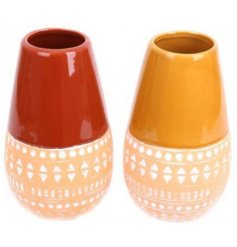 An assortment of tall ceramic vases decorated with autumnal themed tones and geometric patterns