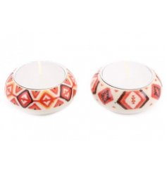 A mix of small round tlight holders with a charming autumnal coloured pattern,  sure to add an earthen feel to any spac