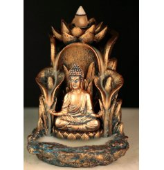 A golden Thai Buddha meditating within a lotus flower surrounded by the enchanting mist of the backflow incense burner.