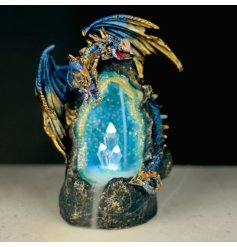 A deep blue crystal cave enchanted with mist from the backflow incense burner and guarded by a mystical dragon.