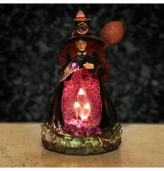 A detailed witch with crystal filled cave lit with LED lights and backflow incense burner to release a mystical scent.
