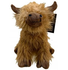 A cute little highland cow doorstop covered in a fuzzy faux fur trim