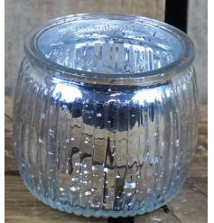 Covered with a silver Speckled Decal, this glass tlight holder will be sure to place perfectly in any home space