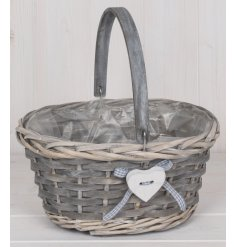 a small basket complete with a sturdy handle and sweet heart decal