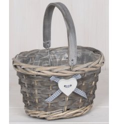 Complete with a charming heart and ribbon decal, this small wicker basket is perfect for Easter Egg hunts!