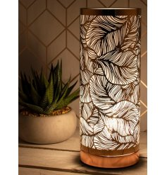 A unique and stylish table lamp with a bold leaf design pattern. A luxury living interiors item for the home.