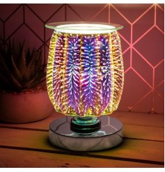 oil burner/wax melt lamp with dish, creating a 3-dimensional, multicoloured burst effect.