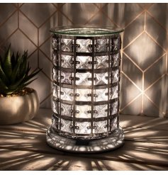 this Glitz themed Aroma Lamp will be sure to place perfectly in any home with its added Crisp White LED centre