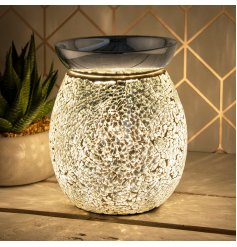 A gorgeous LED glass lamp featuring a crackled silver mosaic design and metal dipped dish for oil and wax melting