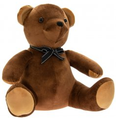 A charming little teddy bear doorstop covered with a lush brown velveteen fabric