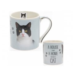 A beautifully illustrated black and white cat portrait presented on a fine china mug with the quote