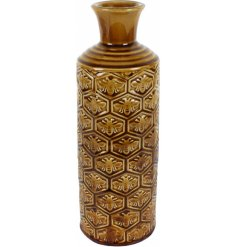 A vintage style vase with a honeycomb and bee pattern for a vintage inspired home.