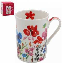 set with an array of colourful flowers, this beautiful Mug is part of a new range