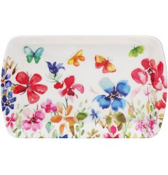 Set with an array of colourful flowers, this beautiful small serving tray is part of a new range