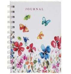 A hardback notebook featuring a brightly coloured array of flowers and butterflies