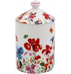 A sweetly scented wax candle placed with a pretty patterned Ceramic Jar