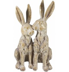 Twin posing hares in a rustic driftwood finish.