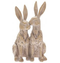 A pair of sitting hares presented in a new driftwood finish for a rustic, country feel.