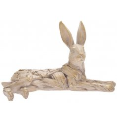 A posed lying hare in a rustic driftwood finish.