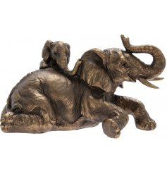 A beautifully realistic ornamental Mother Elephant and her Calf, set with a bronzed tone