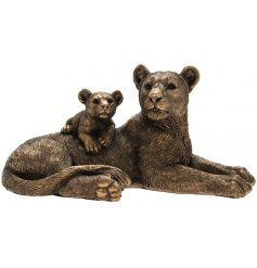 A beautifully realistic ornamental Lioness and her cub, set with a bronzed tone