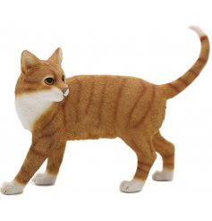 A posed cat figurine with a ginger tabby colouring