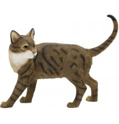 A standing cat figurine with brown tabby markings