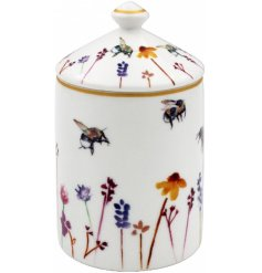 A smooth white ceramic candle pot with a beautifully printed Busy Bee Garden themed decal