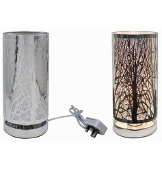 A unique and stylish table lamp with a bold woodland design pattern. A luxury living interiors item for the home.