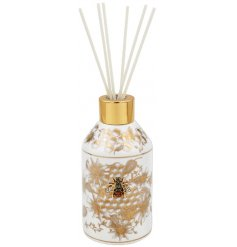 A golden trimmed Diffuser decorated with a luxe golden Honeycomb design
