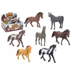 An assortment of different coloured horse toys,