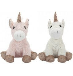Two fluffy, knitted effect unicorns with rose gold tinted glitter features.