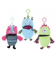 A mix of 3 colourful and quirky worry monster soft toys with clips.