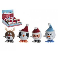 A mix of 4 novelty Christmas character wind up toys, including some with Santa hats.