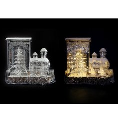 A clear glass Train ornament complete with a warm white LED central glow emitting from it