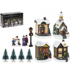 Create a unique Christmas village with this set of 12 scenic items, including light up houses.