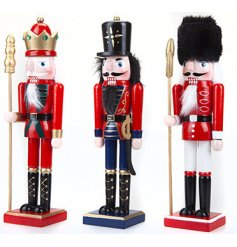 A mix of standing wooden Nutcracker ornaments each set with its own festive trimmings and decals