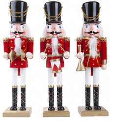 A mix of 3 standing Traditional Band Playing Nutcracker Ornaments, each set with its own festive trimmings