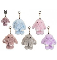 An assortment of fuzzy fabric bunny keyrings in a range of pastel colours