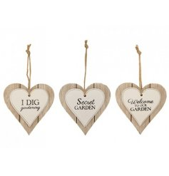 Three assorted hanging, heart shaped plaques. Each with a garden themed quote.