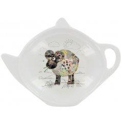 A small white plastic teabag tidy with a colourful Raymond Ram Decal