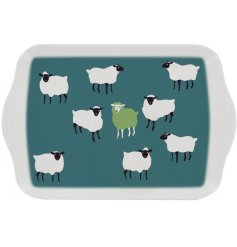 A stylish green serving tray decorated with a sheep design