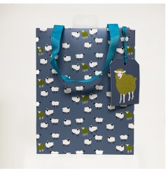 A stylish green gift bag decorated with a sheep design