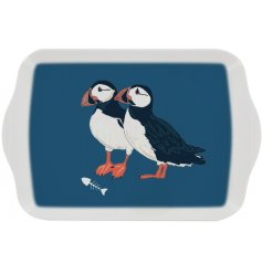A charming melamine serving tray in a navy tone covered with a cute Puffin decal
